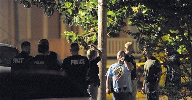 NC officer shot dead while serving murder warrant