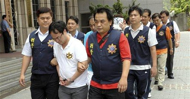 Taiwan says 600 arrested in Asian swindling rings