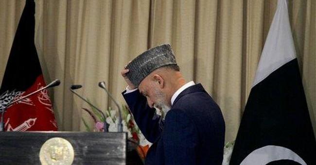 Blasts kills 34 in Pakistan, as CIA chief visits