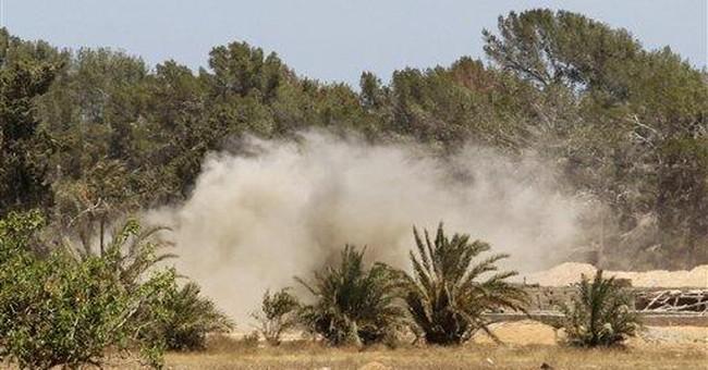 Libya's rebels claim resurgence; government denies