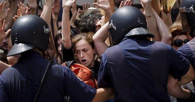 Spanish protesters end 3 week camp-out in Madrid
