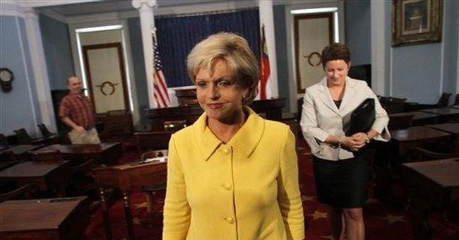 Perdue becomes 1st NC gov to veto budget plan