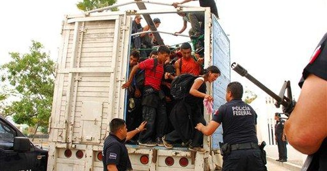 Mexico finds 210 migrants crammed in truck
