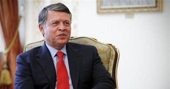Tossed bottles or warm 'welcome' for Jordan's king