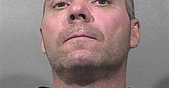 Mich. woman's body found in Ind. pond; man charged