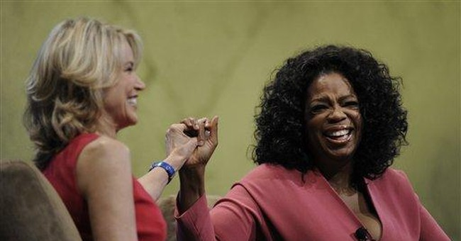 Winfrey says she's 'all in' at her cable network