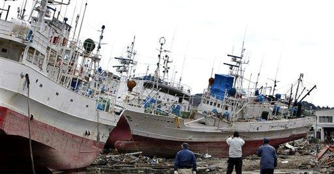 Ships tossed ashore by Japan tsunami get rescued