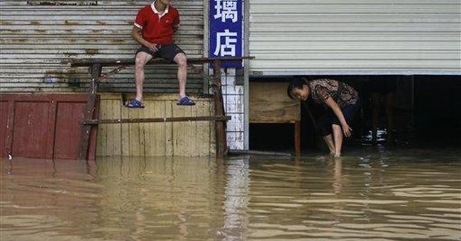 Floods, lightning kill 8 as heavy rains hit China