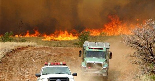 Wind-driven wildfires prompt more evacuations
