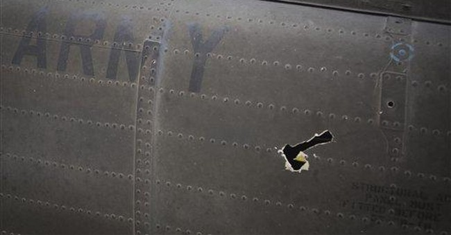 Lucky charms and bullet holes in Afghan helicopter