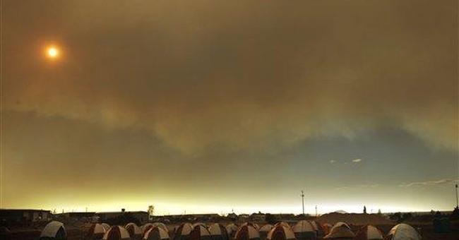 Thousands battling Ariz. fire find respite in camp