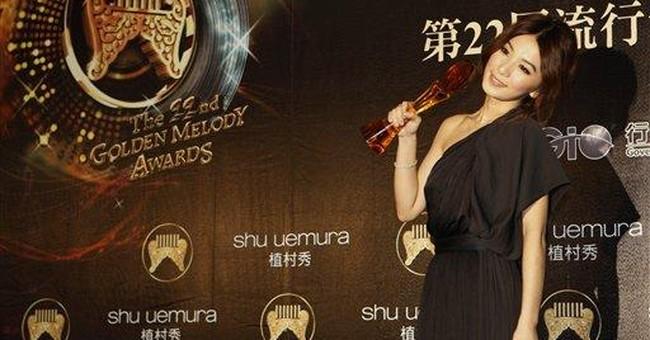 Chou, veteran Lee split top Golden Melody Awards