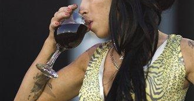 Ailing Amy Winehouse cancels part of European tour
