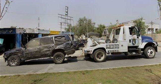 French Embassy convoy hit by bomb in Baghdad