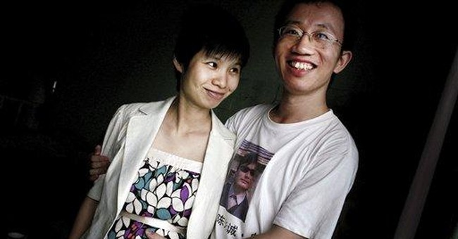 Wife visits jailed China activist ahead of release