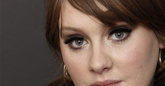 Adele reschedules concerts after laryngitis