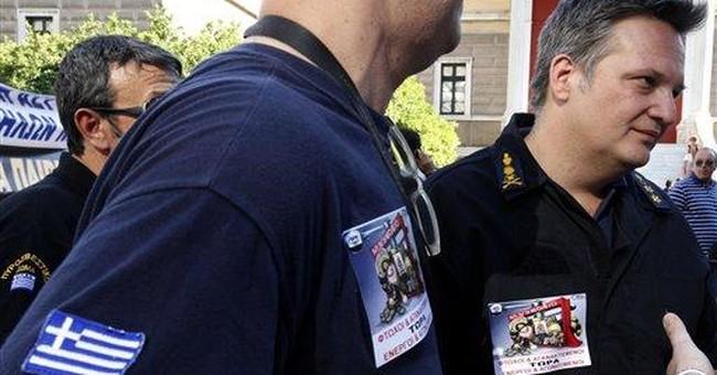Greece presses banks, low-earners in debt crisis
