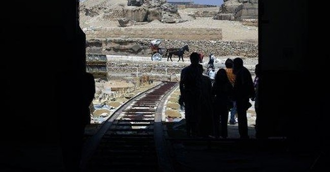 Egypt to restore ancient boat found near pyramid