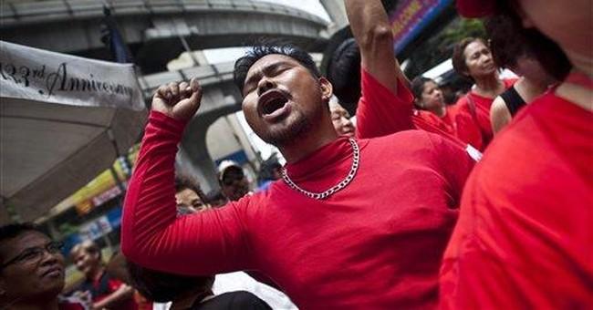 Thai PM rallies crowds at sensitive protest site