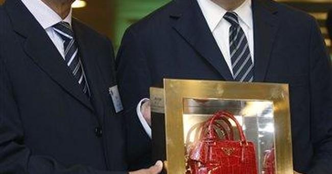 Prada shares flat in Hong Kong trading debut