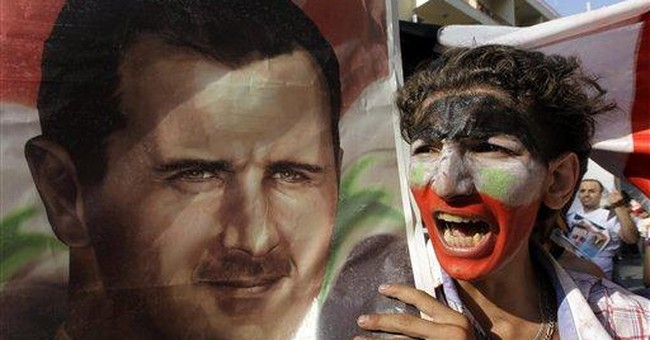 15 die as Syrians march demanding Assad's ouster