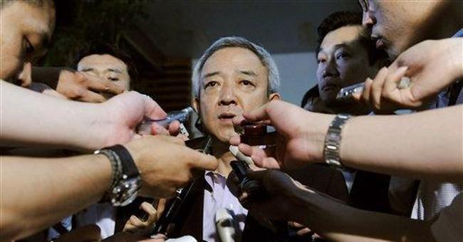 Japan PM adds Cabinet jobs on tsunami, nuke crisis
