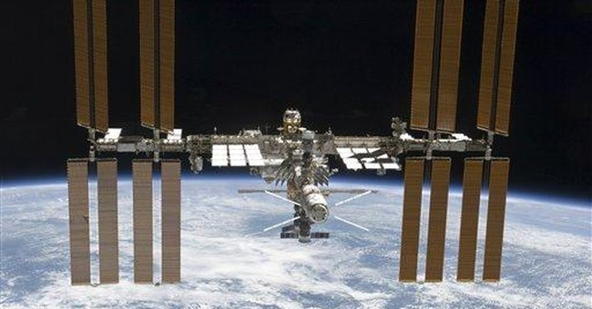 6 station astronauts take shelter from space junk