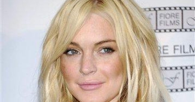 Lohan released from house arrest after 35 days