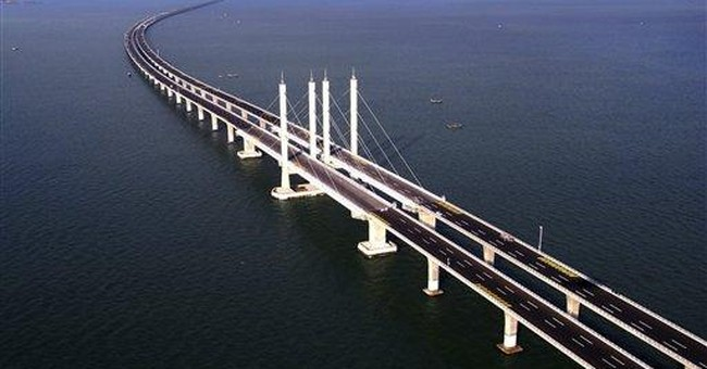 China opens world's longest sea bridge _ 26 miles