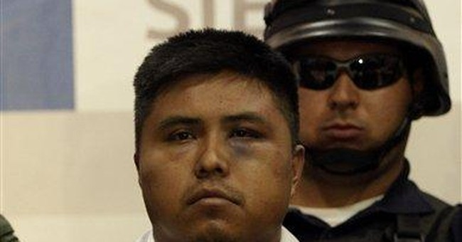 Mexico troops detain hit man linked to mass graves