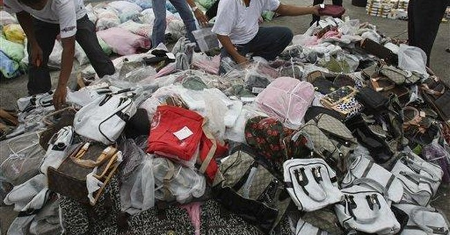 Philippines slashes, smushes haul of pirated goods