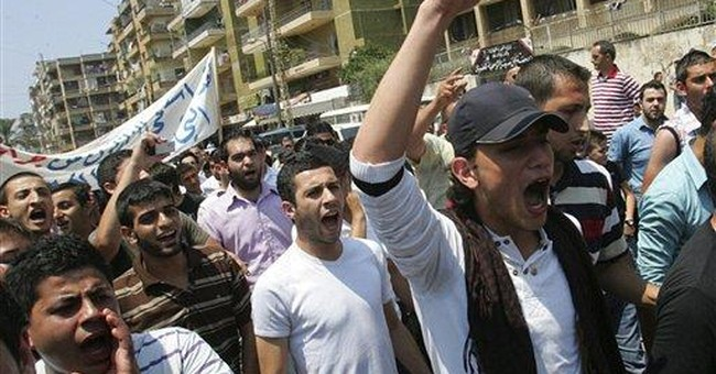Huge protests grip Syria; 14 killed in clashes