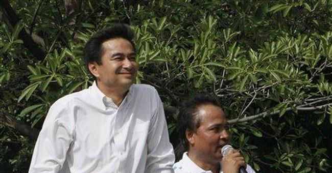Ex-Thai PM, in exile, looms large in tense vote
