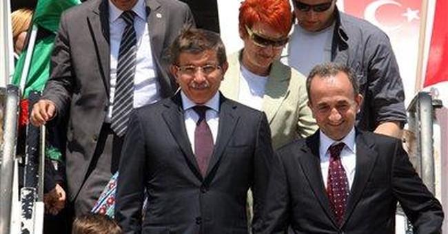 Turkey recognizes Libya rebels, promises more aid