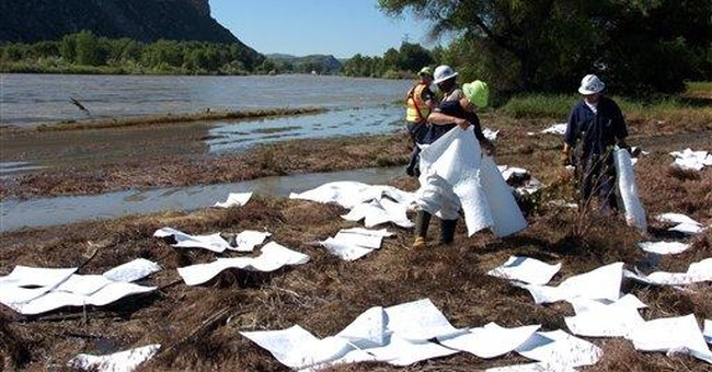 Rising river complicates Exxon oil spill cleanup