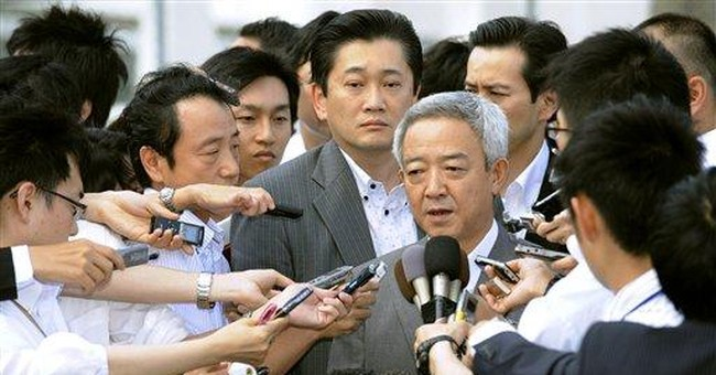 Japan reconstruction minister resigns over remarks