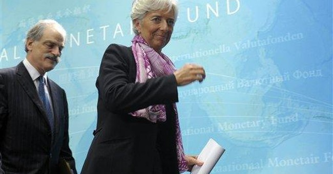 Lagarde, taking over IMF, vows to diversify board