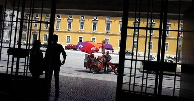 Ailing Portugal reels from credit downgrade