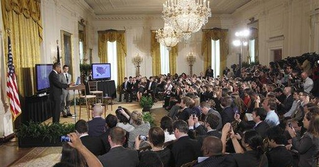 Obama takes on 'tweeters' in Twitter town hall