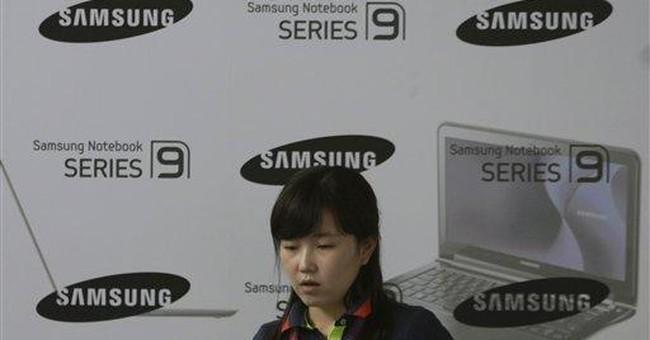 Samsung says 2nd-quarter operating profit fell