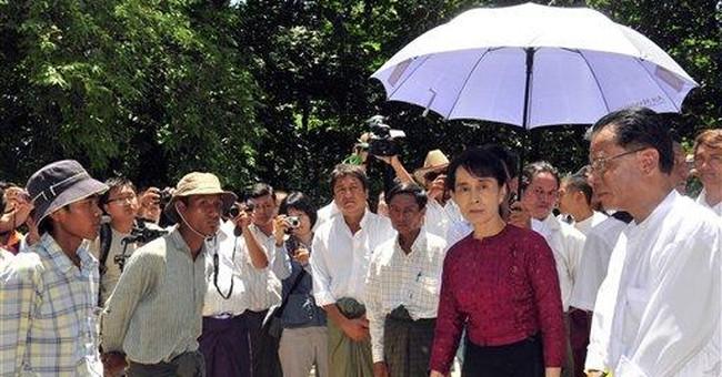 Bigger crowd greets vacationing Suu Kyi in Myanmar