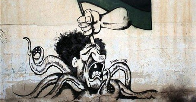Libya's rebel street artists take aim at Gadhafi