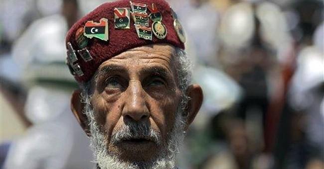 Shouting, Libya's Gadhafi lashes out at NATO