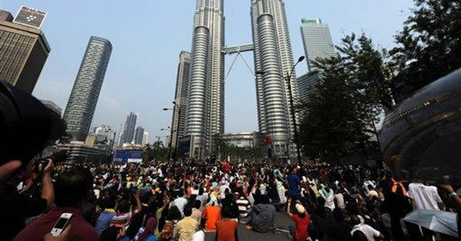 Malaysia fires tear gas at protest, arrests 1,667
