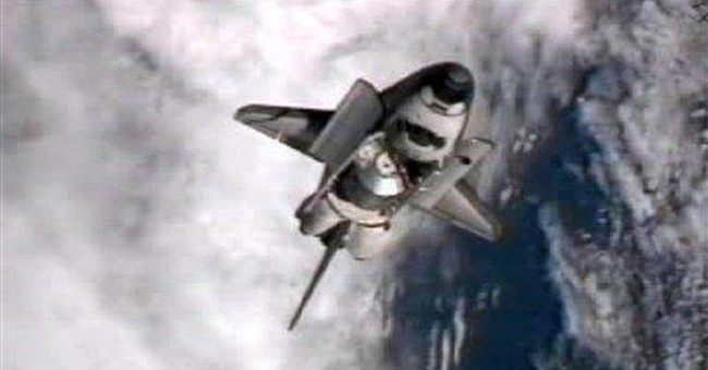 Shuttle delivers ton of groceries to space station