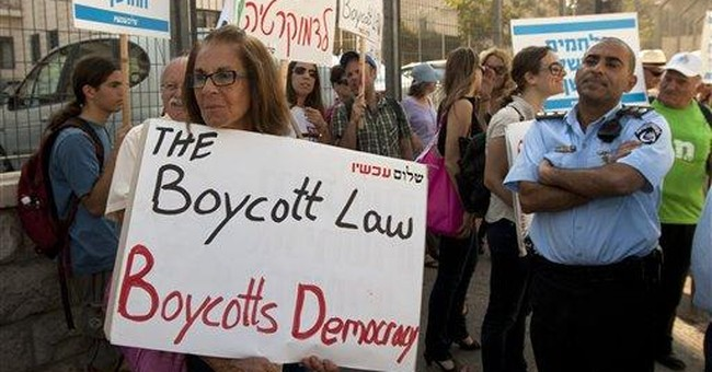 Israeli leader defends contentious boycott law