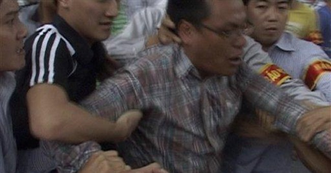 Vietnam detains journalists, anti-China protesters