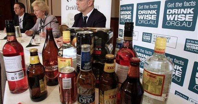Australia puts health warnings on booze bottles