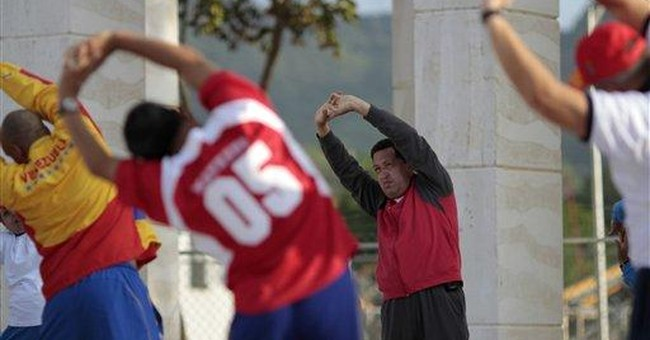 Chavez prays, vows to speed socialist drive