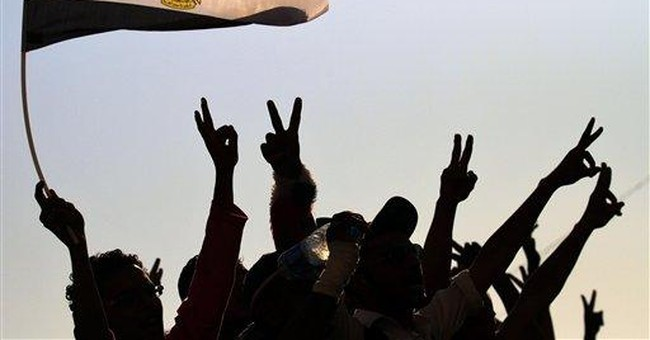 Egypt fires hundreds of police as protests grow